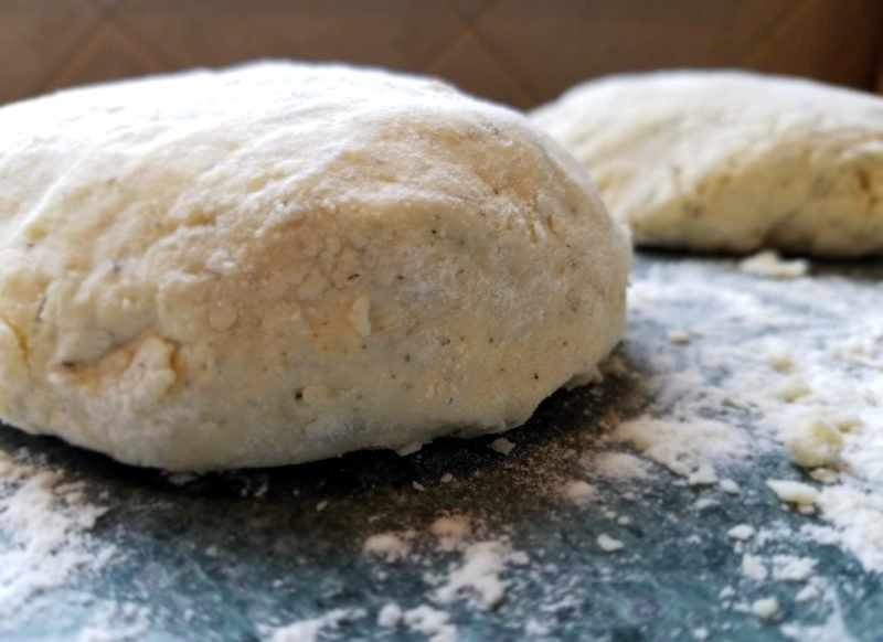 dough formed into discs on floured surface