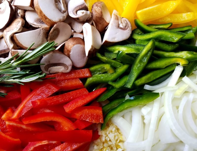 Topping ingredients - sliced onion, bell peppers and mushrooms