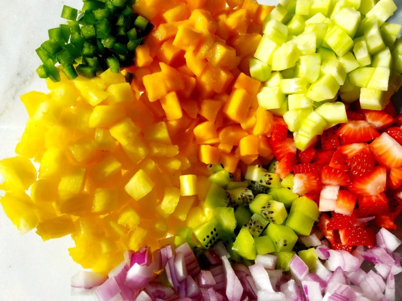 Salsa Ingredients Chopped in glass bowl.