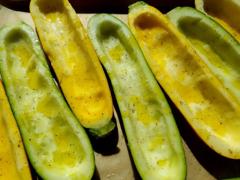 Zucchini halved lengthwise and hollowed out.