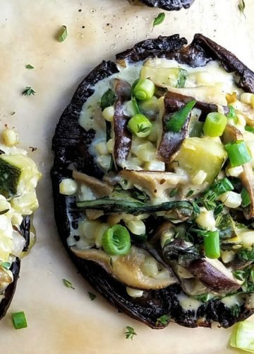Mushroom Stuffed Portobellos | Give it Some Thyme – giant portobello mushrooms mounded high with shiitakes, zucchini, arugula, corn, feta and fresh herbs! #stuffedmushrooms #stuffedportobellomushrooms #mushroomrecipes #portobellomushroomrecipes #vegetarianrecipes #sidedishes #appetizers #fallrecipes #giveitsomethyme