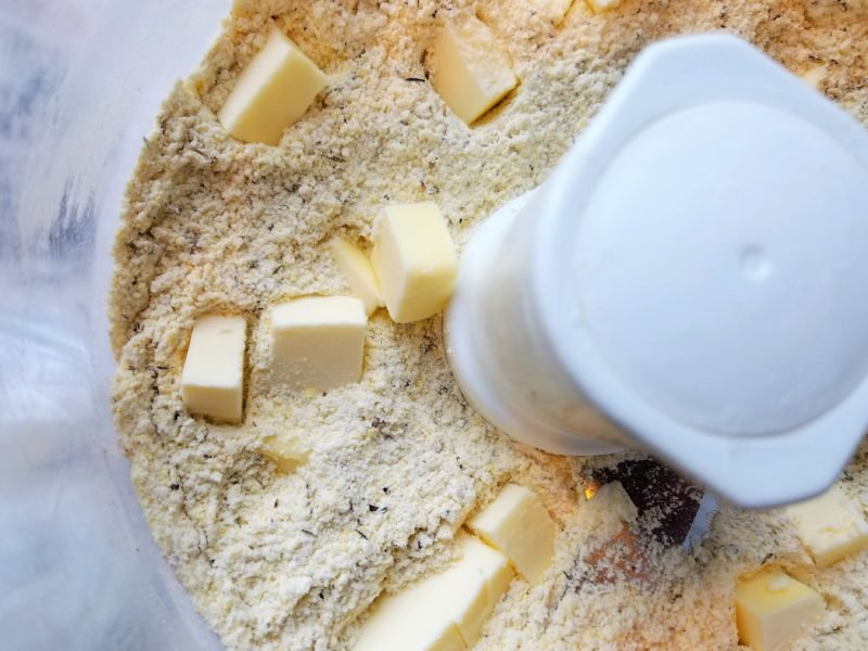 Dough ingredients pulsed in food processor and cubed butter being added.