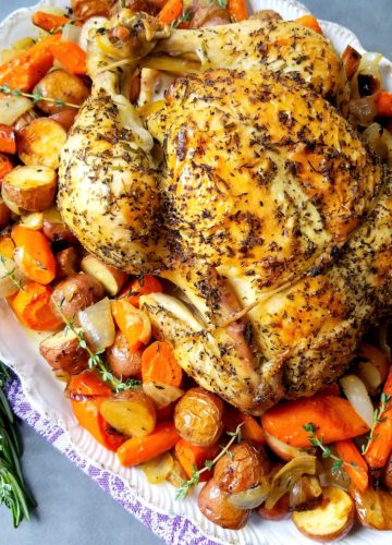 Lemon Roasted Chicken with Herbs Potatoes Carrots and Onion