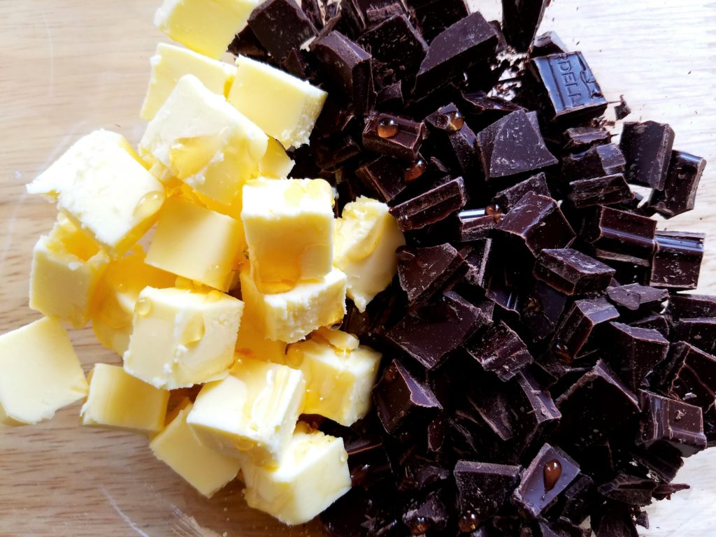 Dark Chocolate Pieces Cubed Butter and Honey Ready to Melt for Glaze