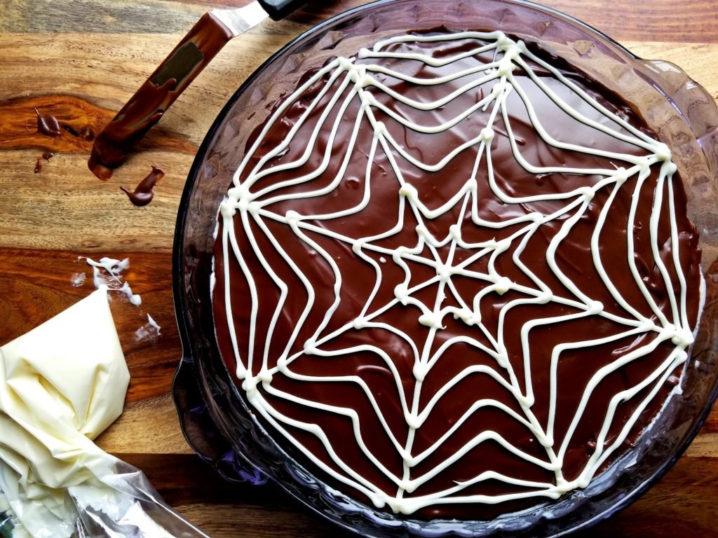 Spooky Choc Glazed Cannoli Dip with White Chocolate Web Piped On Top