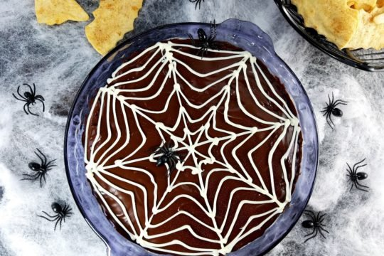 Spooky Chocolate Glazed Cannoli Dip - creamy, fluffy cannoli dip loaded with mini chocolate chips and blanketed with a silky, dark chocolate glaze and white chocolate web. Perfect Halloween treat! | giveitsomethyme.com