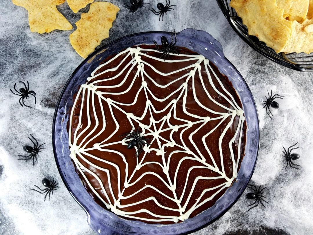 Spooky Chocolate Glazed Cannoli Dip - creamy, fluffy cannoli dip loaded with mini chocolate chips and blanketed with a silky, dark chocolate glaze and white chocolate web. Perfect Halloween treat!   giveitsomethyme.com