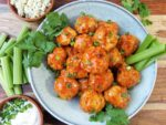 Buffalo BBQ Chicken Meatballs - served with celery sticks, ranch dressing, and crumbled blue cheese. So good! | giveitsomethyme.com