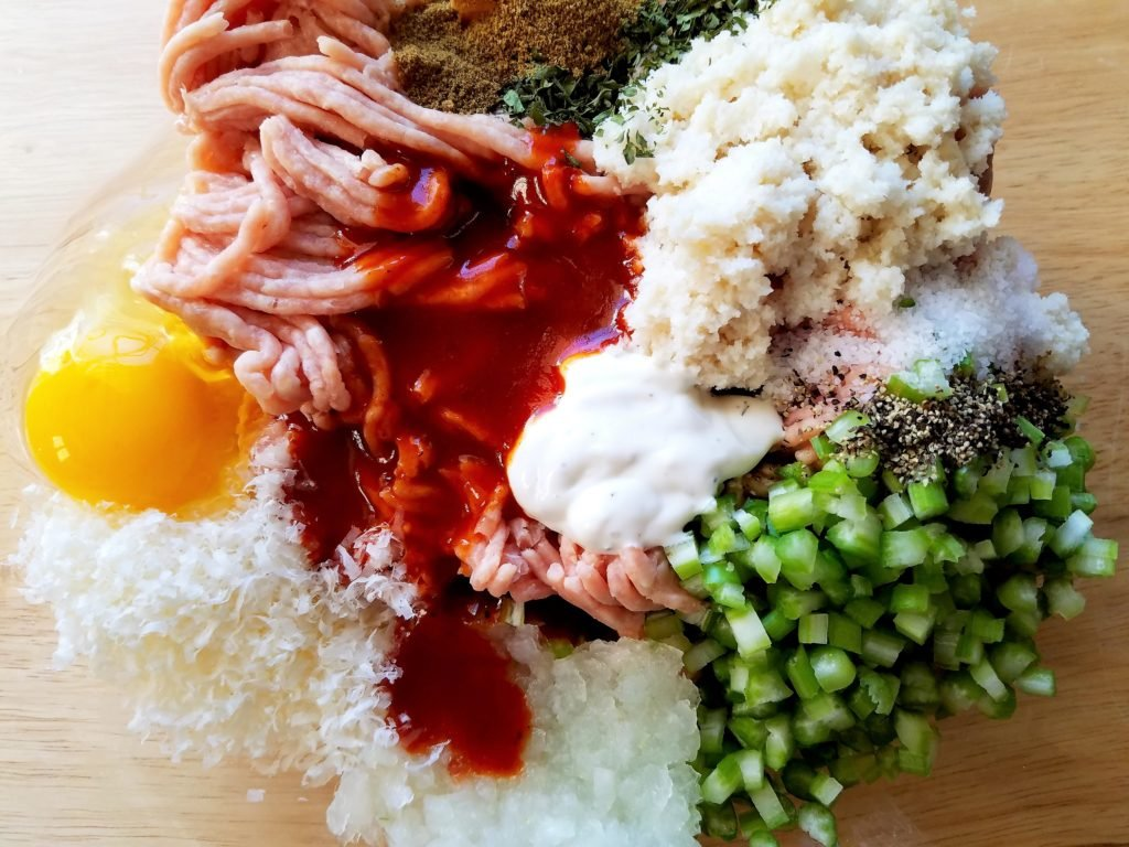 Buffalo BBQ Meatball Ingredients - ground chicken, buffalo bbq sauce, celery, grated onion, egg, breadcrumbs and spices