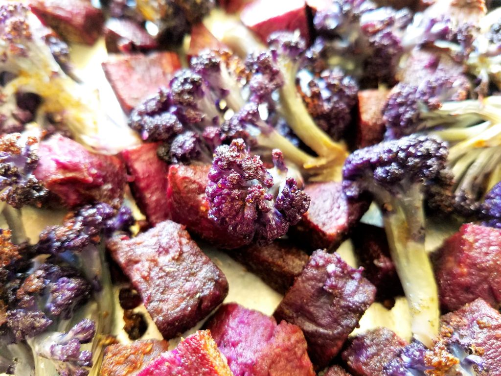 Close Up of Roasted Purple Cauliflower and Sweet Potatoes