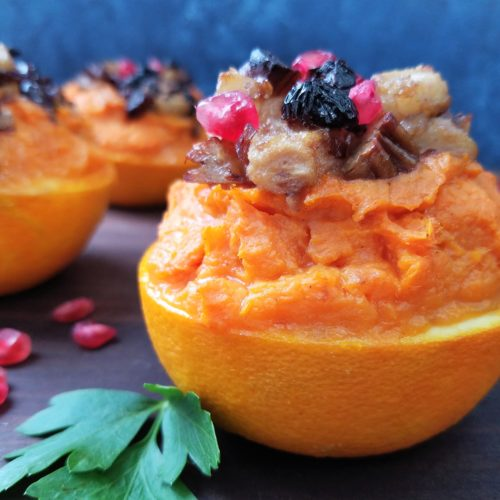 Sweet Potato Stuffed Orange Cups Topped with Caramelized Pears, Pecans & Cranberries | giveitsomethyme.com
