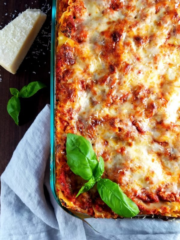 Turkey Bolognese Lasagna ready to serve with parmesan cheese.