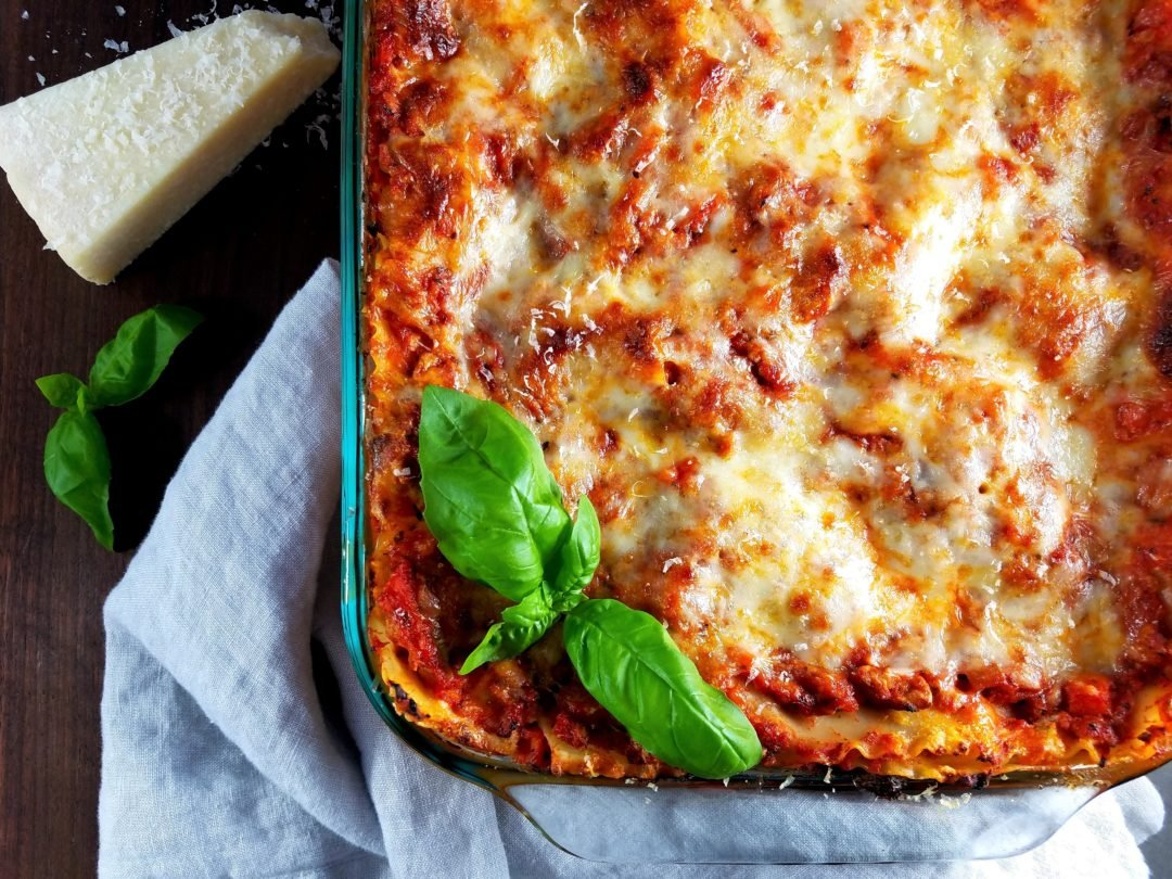 Turkey Bolognese Lasagna | giveitsomethyme.com - a delicious make-ahead, crowd-pleasing recipe that combines all the great flavors of a traditional bolognese with a tad less guilt using ground turkey and turkey sausage. #lasagna #lasagnarecipe #homemadelasagna #turkeylasagna #pastadinner #pastadinnerrecipes #pastadinnerideas #pastadinnerparties #falldinnerideas #falldinnerrecipes #giveitsomethyme
