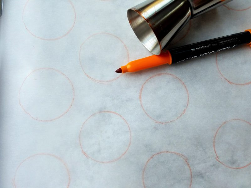 Circles traced on parchment for macaron shells.