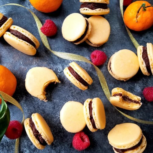 Orange French Macarons with Chocolate Raspberry Buttercream   giveitsomethyme.com - tender, chewy little sandwiches laced with orange extract and filled with a smooth, luscious chocolate raspberry buttercream! #macarons #macaronsrecipe #macaronshowtomake #christmasmacarons #frenchmacarons #frenchmacaronsrecipe #orangemacarons #christmascookies #christmascookierecipe #giveitsomethyme