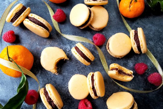 Orange French Macarons with Chocolate Raspberry Buttercream | giveitsomethyme.com - tender, chewy little sandwiches laced with orange extract and filled with a smooth, luscious chocolate raspberry buttercream! #macarons #macaronsrecipe #macaronshowtomake #christmasmacarons #frenchmacarons #frenchmacaronsrecipe #orangemacarons #christmascookies #christmascookierecipe #giveitsomethyme