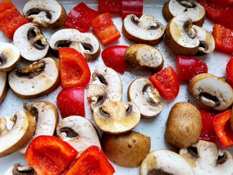 Red Bell Pepper and Mushroom Slices on sheet pan ready to bake