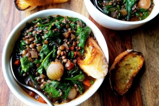 Red Wine Braised Lentils with Spinach | giveitsomethyme.com - This hearty stew is chock-full of nutrients and rich, earthy flavor. Vegan comfort food at its finest! #veganrecipe #lentilrecipe #braisedlentils #redwinerecipe #spinachrecipe #frenchgreenlentils #frenchgreenlentilsrecipes #lentilsandspinach #lentilsandspinachrecipes #lentilsandspinachglutenfree #lentilsandspinachsoup #meatlessmonday #meatlessmondayrecipes #meatlessmondaydinner #veganstew