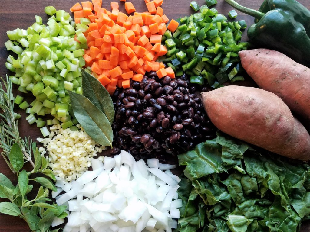 Black Bean Stew Ingredients - black beans, sweet potatoes, carrots, onion, celery, poblano pepper, garlic, swiss chard and herbs