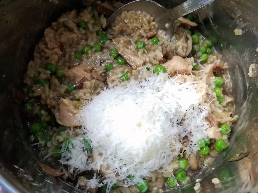 Instant Pot Chicken Risotto Done Cooking, Peas and Parmesan getting Stirred In