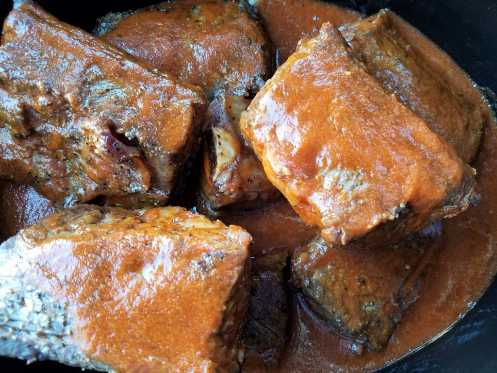 Short Ribs in Slow Cooker Covered in Ancho Chile Sauce