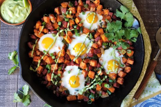 Sweet Potato Hash with Baked Eggs Served in Skillet with Avocado Cilantro Crema | giveitsomethyme.com