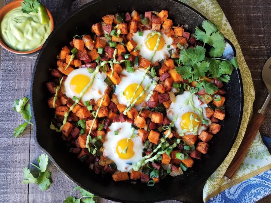 Sweet Potato Hash with Baked Eggs & Avocado Cilantro Crema | giveitsomethyme.com - breakfast, lunch, or dinner, this gluten-free Sweet Potato Hash with Baked Eggs and Avocado Cilantro Crema is a hearty, delicious meal anytime! #sweetpotatohash #sweetpotatohashhealthy #sweetpotatohashwhole30 #sweetpotatohashwitheggs #sweetpotatohashskillet #breakfastrecipe #sweetpotatorecipe #skilletrecipe #giveitsomethyme #sweetpotatoesandeggs #sweetpotatoesandeggsrecipes #sweetpotatoesandeggsbreakfast