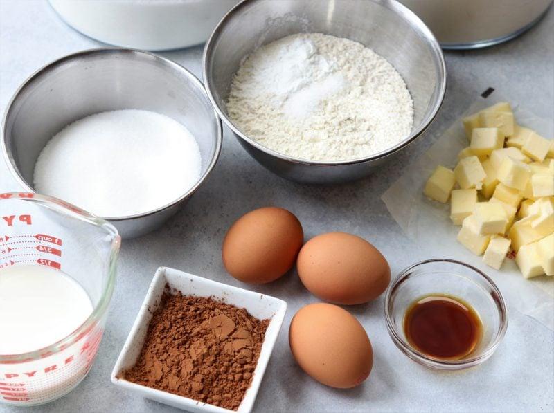 Cupcake ingredients on white surface