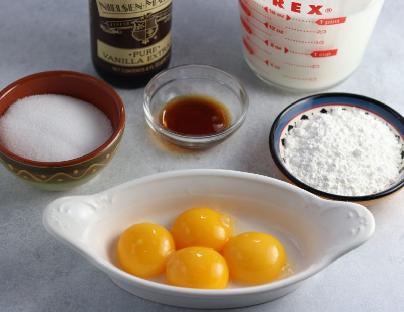 Pastry cream ingredients on white surface.