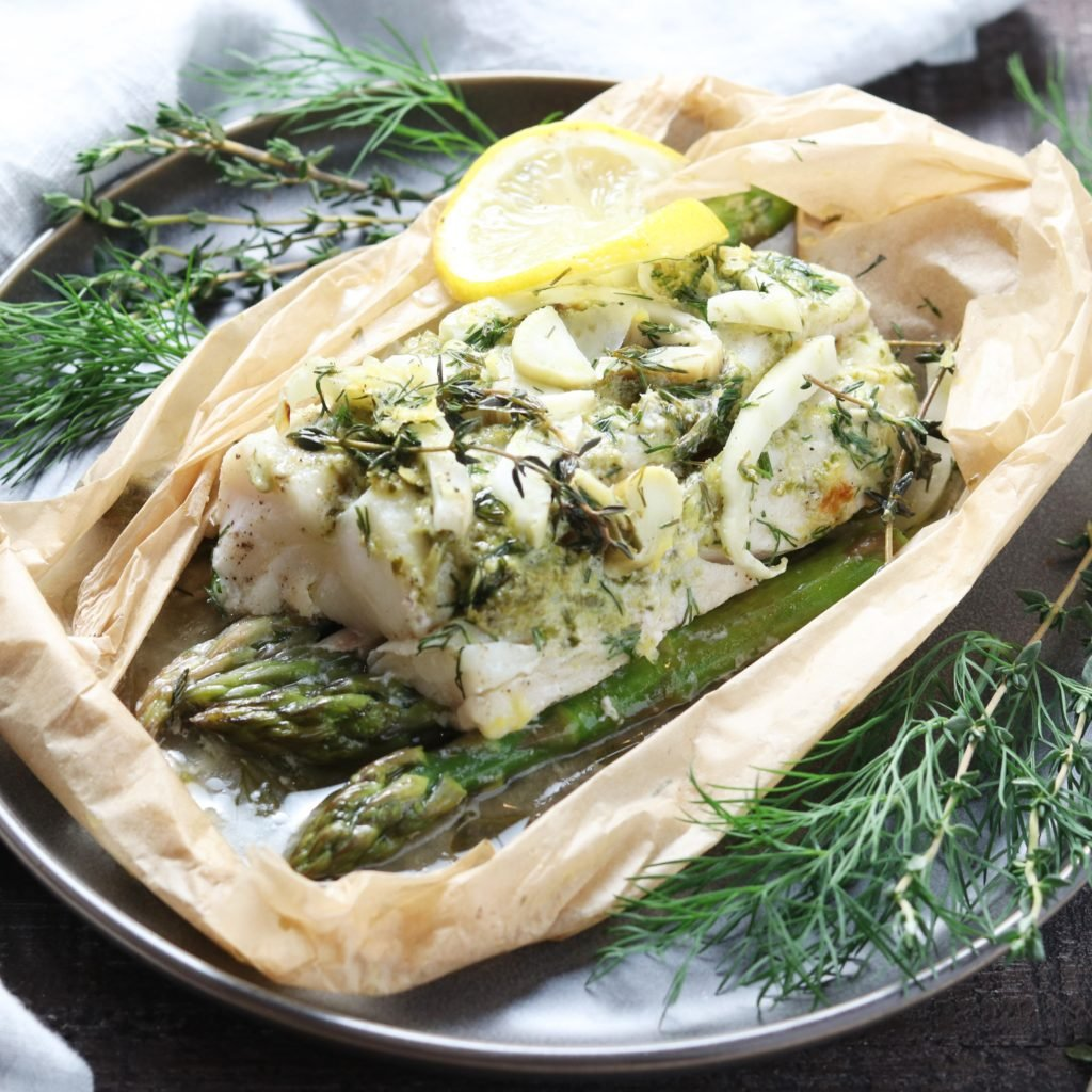 Cod Asparagus & Fennel Packets | giveitsomethyme.com - these easy fresh cod packets are laced with lemon, thyme, dill, and spiked with dry vermouth. Gluten-free and on the table in 45 minutes! #fishdinner #fishdinnerrecipes #fishdinnerideas #fishdinnerhealthy #healthydinners #quickandeasydinners #codrecipes #cod #codfishrecipes #codrecipeshealthy #codhealthy #bestcodrecipes #bestcoddinners #fishpackets #fishpacketsoven #giveitsomethyme