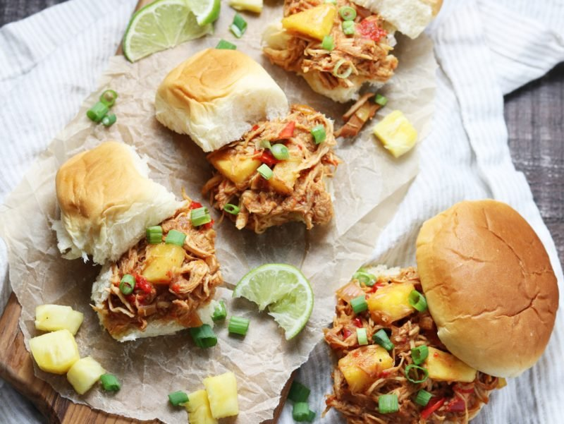 Slow Cooker Hawaiian Chicken Sloppy Joes | giveitsomethyme.com - Tender shredded chicken and pineapple bathe in a sweet and tangy Hawaiian-inspired sauce. Perfect for game days and busy weeknights! #hawaiianchicken #hawaiianchickenrecipes #hawaiianchickencrockpot #hawaiianchickenslowcooker #hawaiianchickeneasy #sloppyjoes #sloppyjoesrecipe #slowcookerrecipe #crockpotrecipe #slowcookerchicken #slowcookerchickenrecipes #crockpotchicken #crockpotchickenrecipes #healthyfalldinners #gamedayrecipe