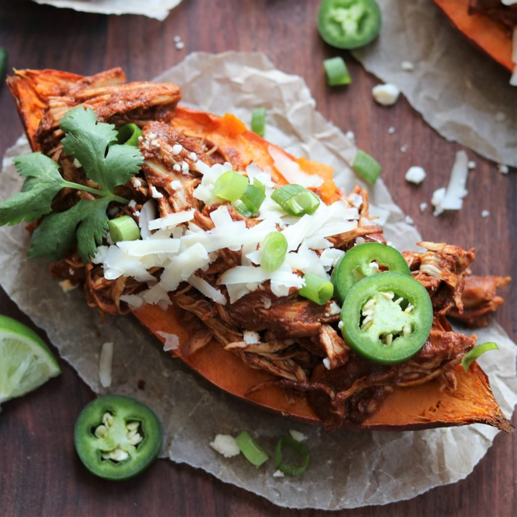 Chicken Mole Stuffed Sweet Potato topped with grated cheese and jalapeno slices - giveitsomethyme.com