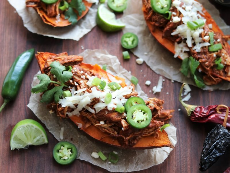 Slow Cooker Chicken Mole Stuffed Sweet Potatoes | giveitsomethyme.com - moist shredded chicken bathes in a perfectly spiced, rich and flavorful mole sauce and tender sweet potatoes perfectly complement this classic Mexican dish! #mexicandinner #stuffedsweetpotatoes #chickenmole #chickenmolerecipe #chickenmole #chickenmoleeasy #chickenmolecrockpot #chickenmoleslowcooker #slowcookerrecipe #crockpotrecipe #slowcookerrecipeglutenfree #potluckrecipe #giveitsomethyme