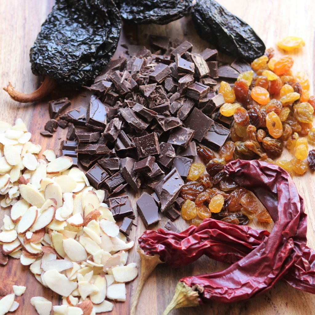 Key Mole Sauce Ingredients - dried chiles, dark chocolate, raisins and almonds