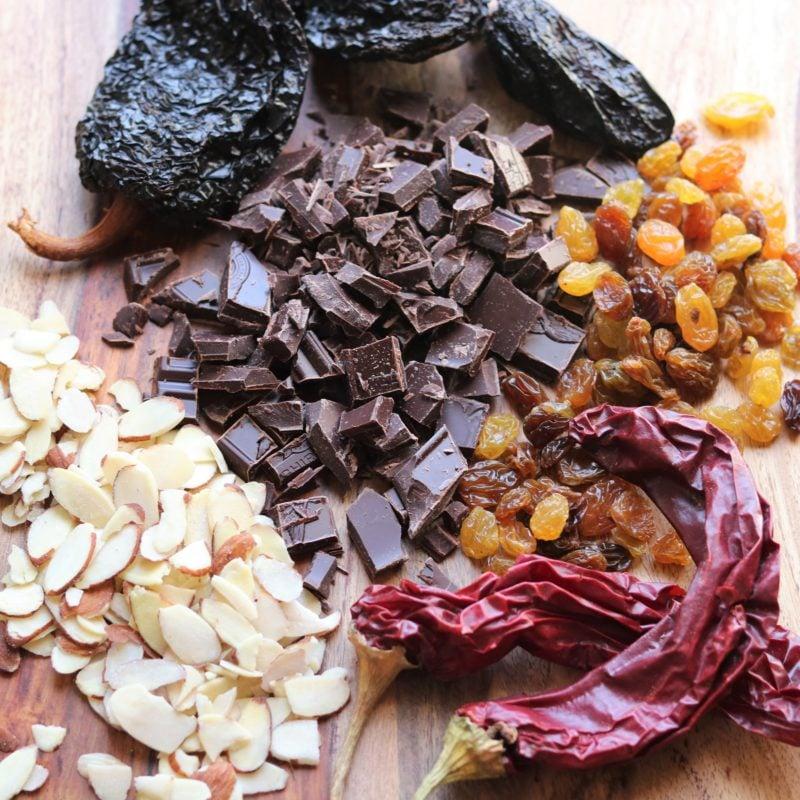 Key Mole Sauce Ingredients - dried chiles, dark chocolate, raisins and almonds.