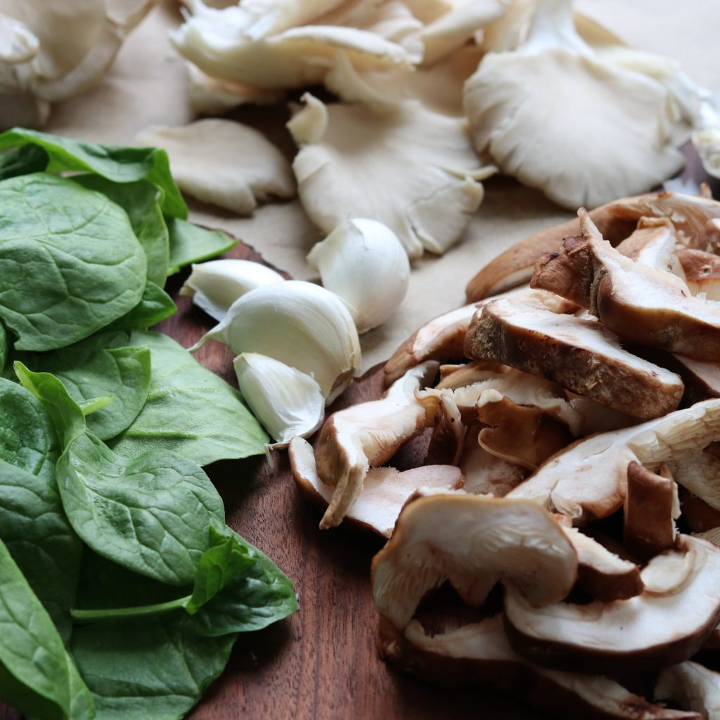 Ingredients - shiitake and oyster mushrooms, baby spinach and garlic
