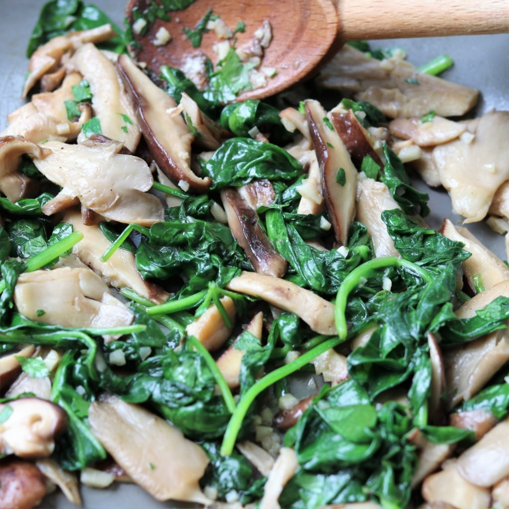 Cooked Mushrooms Spinach and Garlic in White Wine