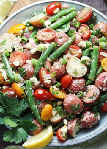 Baby Potato and Green Bean Salad – a super delicious, mayo-free potato salad loaded with cherry tomatoes, shallots and feta coated in a lemony, dijon vinaigrette! #potatosalad #nomayopotatosalad #healthypotatosalad #sidedishes #sidesalads #yearroundsalads #glutenfreesides #giveitsomethyme | giveitsomethyme.com