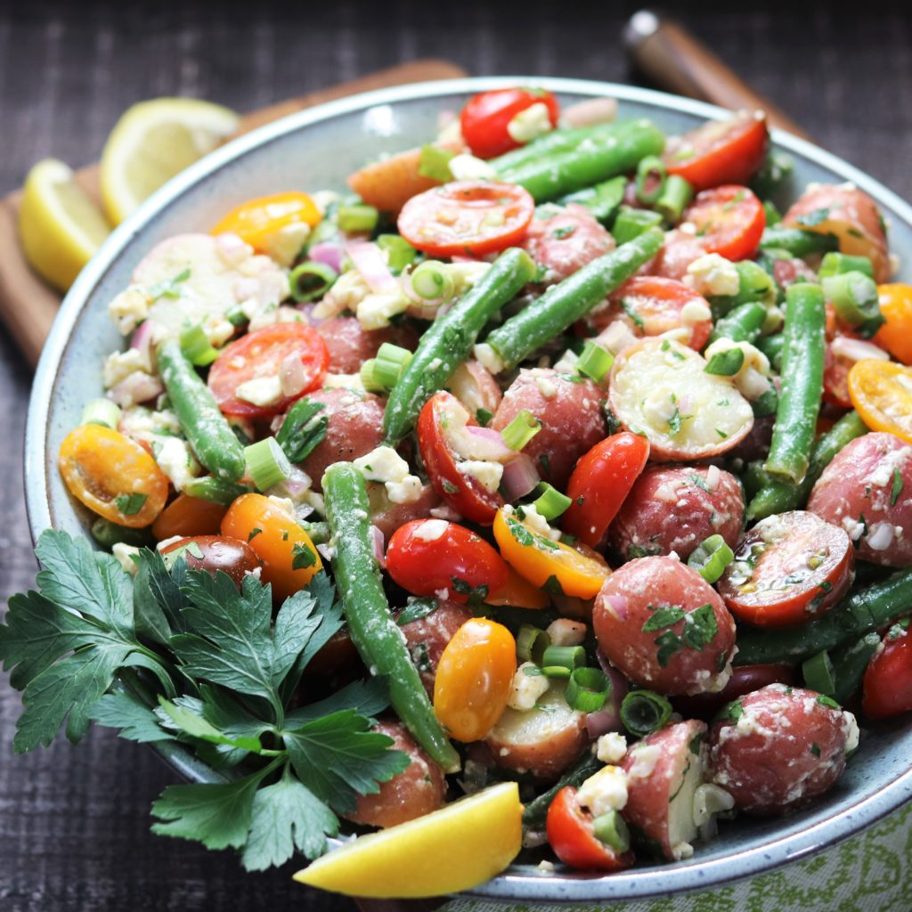 Baby Potato & Green Bean Salad - giveitsomethyme.com – a super delicious, mayo-free potato salad loaded with cherry tomatoes, shallots and feta coated in a lemony, dijon vinaigrette! #potatosalad #potatosaladrecipe #nomayopotatosalad #healthypotatosalad #nomayopotatosaladdressing #bbqsidedishes #bbqsidedishesforacrowd #potatoandgreenbeansalad #potatoandgreenbeanrecipe #potatoandgreenbeanrecipeglutenfree #glutenfreesidedishes