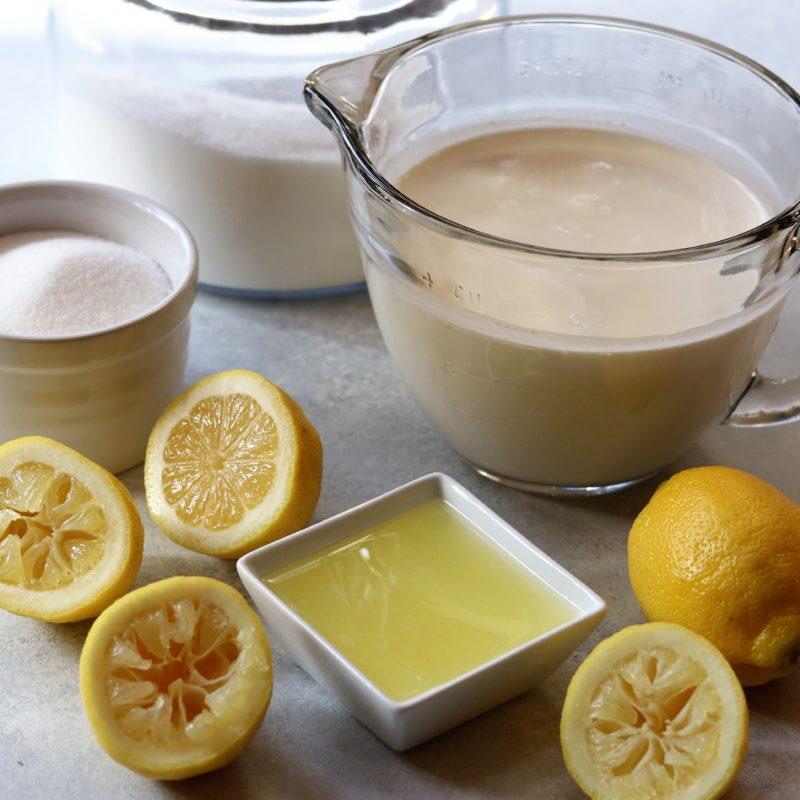 Lemon cream ingredients on work surface.