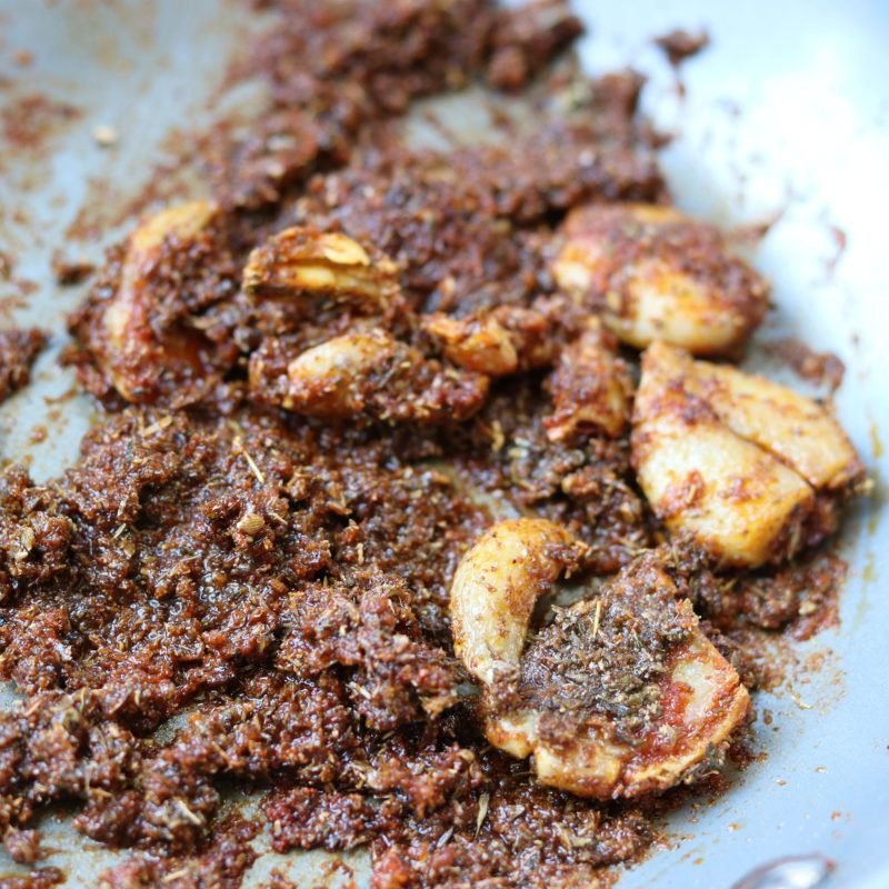 Garlic and Roasted Spices in pan.
