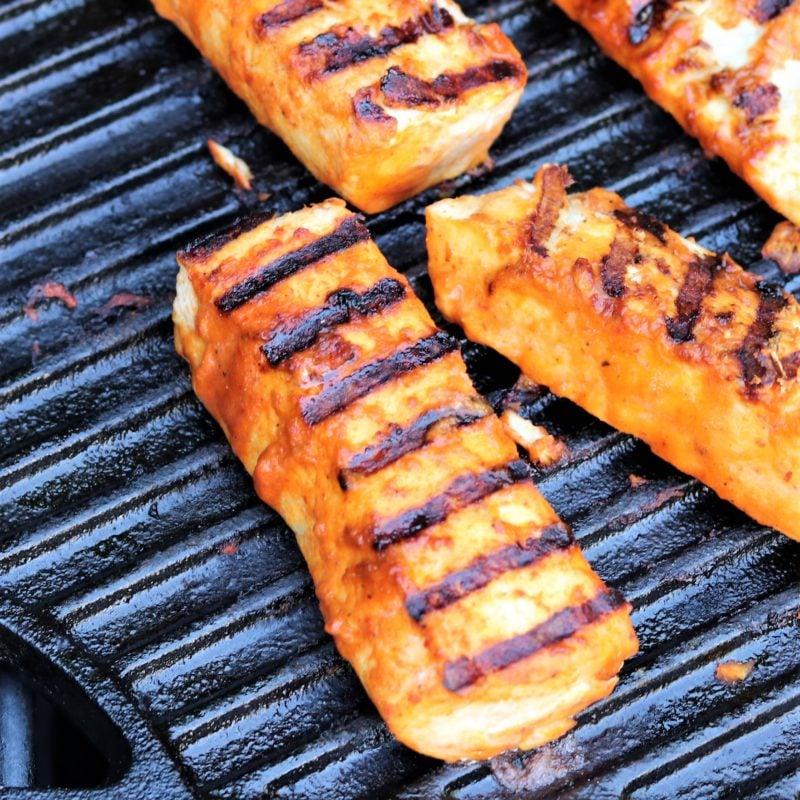 Charred mahi mahi on grill.