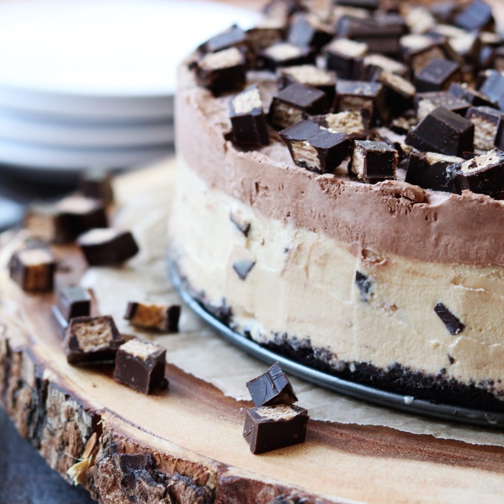 Mocha KitKat Ice Cream Cake - giveitsomethye.com - a decadent blend of coffee and chocolate ice cream studded with dark chocolate Kit Kat pieces all atop a chocolate cookie crumb crust! #chocolatedessert #chocolatedessertrecipe #dessertrecipe #icecreamcake #chocolateicecreamcake #frozendessert #makeaheaddessert #kitkatbars #kitkat #coffeeicecream #mocha