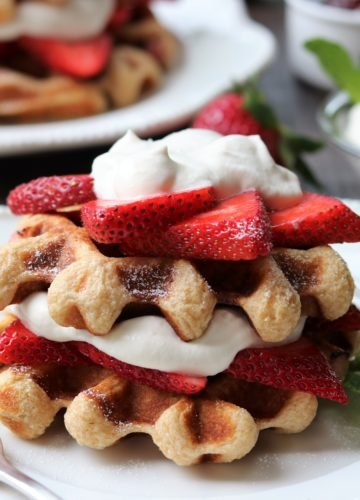 Strawberry Shortcake Buttermilk Waffles | Give it Some Thyme – delicious, crisp yet tender buttermilk waffles layered with fresh strawberries and dollops of maple whipped cream! #waffles #wafflesrecipes #strawberrywaffles #stawberryshortcake #strawberryshortcakewaffles #whippedcream #breakfast #brunch #giveitsomethyme