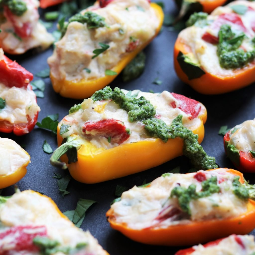 Creamy Chicken Stuffed Mini Peppers w/ Spinach Walnut Pesto | giveitsomethyme.com - sweet little bells loaded with bubbling cheese, tender chicken, roasted peppers, and shallots then drizzled with a tasty spinach pesto! #stuffedpeppers #chickenstuffedpeppers #ministuffedpeppers #ministuffedpepperscreamcheese #ministuffedpeppersappetizers #ministuffedpepperschicken #spinachpesto #spinachpestorecipe #appetizerrecipes #giveitsomethyme