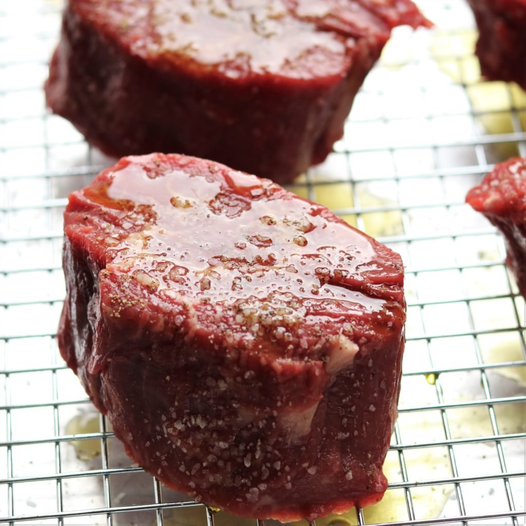 1 1/2-inch thick Filet Mignon Steaks with Olive Oil, Salt & Pepper before Grilling