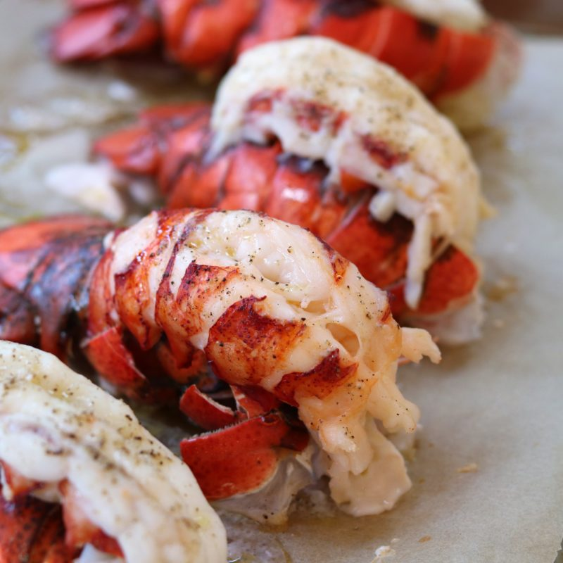 Lobster tails roasted on rimmed sheet pan
