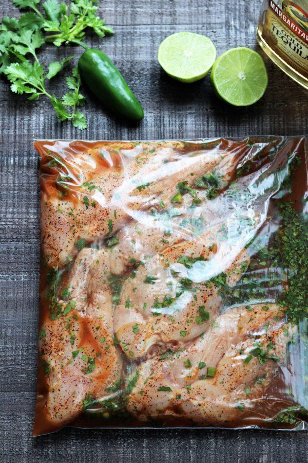 Chicken marinating in ziploc bag.