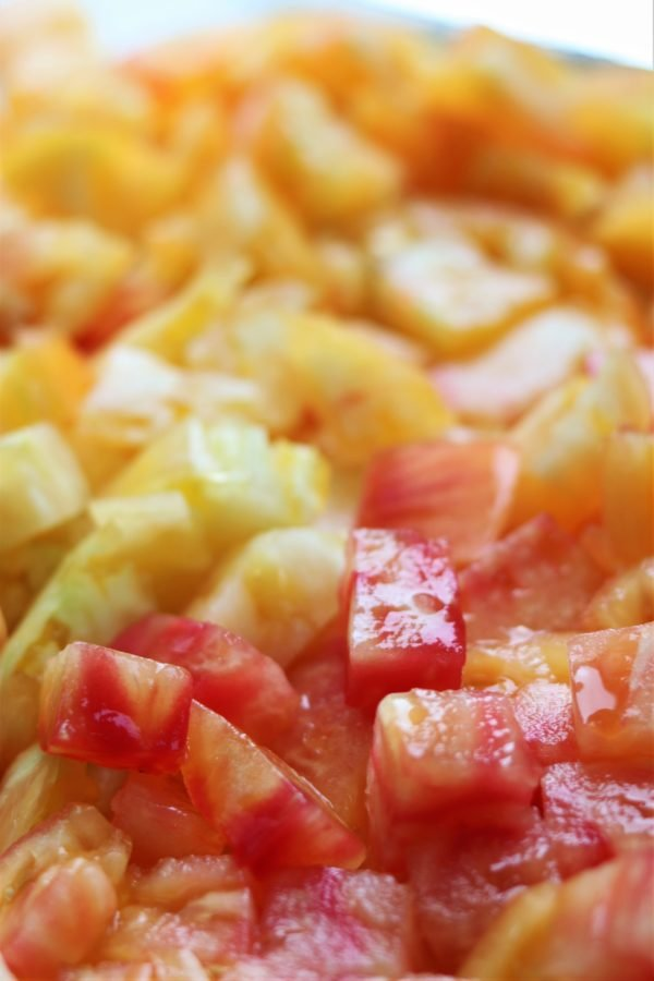 Yellow Heirloom Tomatoes with Pink Swirls Chopped for Gazpacho | giveitsomethyme.com - beautiful and bright heirloom tomatoes need no introduction, just use them unabashedly when in season. #heirloomtomatoes #heirloomtomatophotography #heirloomtomatorecipes #heirloomtomatogazpacho