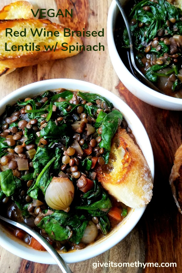 Red Wine Braised Lentils with Spinach | Give it Some Thyme - This hearty stew is chock-full of nutrients and rich, earthy flavor. Vegan comfort food at its finest! #veganrecipe #lentilrecipe #braisedlentils #redwinerecipe #spinachrecipe #frenchgreenlentils #frenchgreenlentilsrecipes #lentilsandspinach #lentilsandspinachrecipes #lentilsandspinachglutenfree #lentilsandspinachsoup #meatlessmonday #meatlessmondayrecipes #meatlessmondaydinner #veganstew